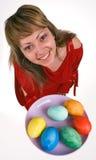 A menina com ovos de easter Imagem de Stock