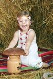 A menina com pão Imagens de Stock