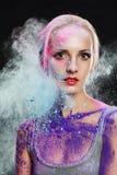 Menina com pó colorido Foto de Stock