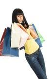 A menina com pacotes da loja Imagem de Stock
