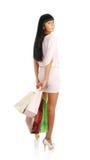 A menina com pacotes da loja Foto de Stock Royalty Free