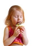 Menina com a pastelaria isolada no branco Imagem de Stock