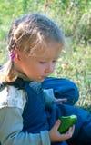 Menina com pepino Fotos de Stock
