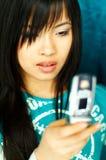 Menina com pilha Foto de Stock