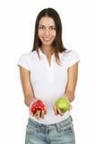 Menina com pimenta de Apple e de Bell Imagem de Stock