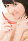 Menina com pimenta de pimentão Fotografia de Stock Royalty Free