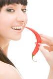Menina com pimenta de pimentão Fotos de Stock