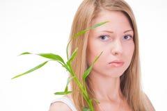 Menina com planta Fotografia de Stock