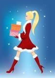 Menina com presentes de Natal Imagens de Stock Royalty Free