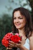Menina com rosas Imagem de Stock
