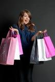 Menina com sacos Foto de Stock Royalty Free