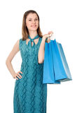 Menina com sacos de compra. Isolado no branco Fotografia de Stock Royalty Free