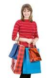 Menina com sacos de compra. Isolado no branco Imagem de Stock