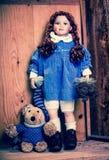 Menina com seu brinquedo Fotos de Stock