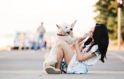 Menina com seu cão Imagens de Stock
