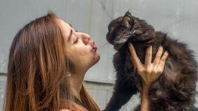 Menina com seu gato Imagem de Stock Royalty Free