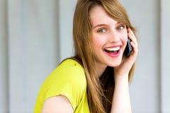 Menina com seu telefone móvel Fotografia de Stock