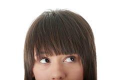 Menina com seus olhos que olham a direita ausente Imagens de Stock Royalty Free