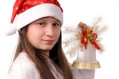 Menina com sino de Natal Fotos de Stock Royalty Free