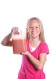 Menina com suco de fruta fotografia de stock royalty free