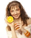 Menina com sumo de laranja Fotos de Stock Royalty Free
