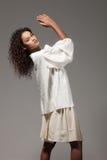Menina com túnica de tamanho grande, retrato Fotos de Stock
