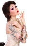 Menina com tatuagens Imagens de Stock