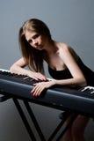 Menina com teclado imagem de stock royalty free