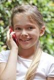 Menina com telefone Foto de Stock Royalty Free