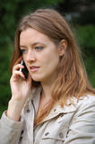 Menina com telefone móvel imagens de stock royalty free