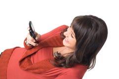 Menina com telefone móvel imagem de stock royalty free