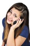 Menina com telefones de pilha Fotografia de Stock