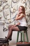 Menina com telefones velhos Foto de Stock Royalty Free