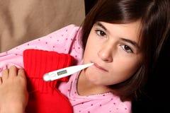 Menina com termômetro Imagem de Stock