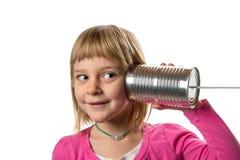 Menina com Tin Can Phone - escutando Imagens de Stock Royalty Free
