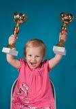 Menina com troféus dourados Fotos de Stock