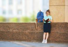 Menina com trouxa Foto de Stock
