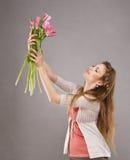 Menina com tulipas Fotografia de Stock