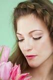 Menina com tulipas Fotos de Stock Royalty Free