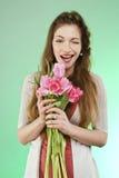 Menina com tulipas Foto de Stock