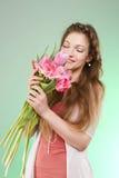 Menina com tulipas Foto de Stock Royalty Free