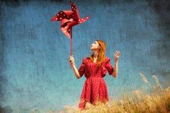 Menina com turbina eólica Fotografia de Stock