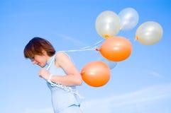 Menina com um balão Fotografia de Stock