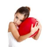 Menina com um balão vermelho imagem de stock