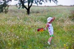 Menina com um brinquedo Fotografia de Stock Royalty Free