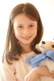 Menina com um brinquedo Imagem de Stock
