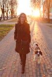 Menina com um cão fotografia de stock royalty free