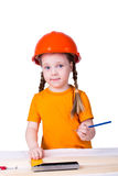 Menina com um capacete da construção Imagem de Stock