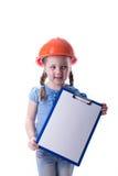 Menina com um capacete da construção Imagens de Stock Royalty Free