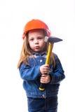 Menina com um capacete da construção Imagens de Stock